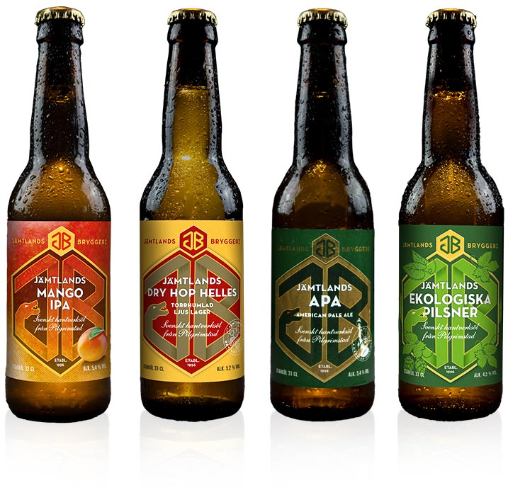 Fyra flaskor med öletiketter för Jämtlands bryggeri